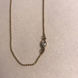 Anthropology necklace gold with marquise crystal.